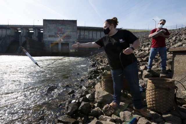 Sarah Pedrick, biologist in the U.S. Army Corps of Engineers Nashville District's Water Management Section, and Mark Campbell, hydrologist, put a water quality instrument into the tailwater of the Stones River below J. Percy Priest Dam in Nashville, Tennessee April 27, 2021 while verifying the accuracy following recent calibrations. (USACE Photo by Leon Roberts)