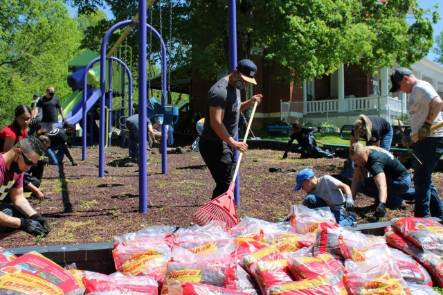 Soldiers from 1st Theater Sustainment Command spread mulch on the playground at SpringHaven Domestic Violence Shelter in Elizabethtown, Kentucky, April 30, 2021. Thirty volunteers helped beautify the playground and gardens in support of Sexual Assault and Awareness Prevention Month.
