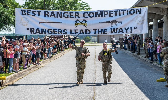 Majs. Matthew Snyder, an instructor in the Department of Military Instruction, and Will Fuller, an instructor at the Department of Physical Education, gave their all during the final stretch of the culminating two-mile run during 37th annual David E. Grange Jr. Best Ranger Competition. Fifty teams out of 26 units competed during the competition enduring two grueling days and nights of obstacles that tested their mental awareness and attention to detail, stamina and endurance, and technical proficiency. The 2021 Best Ranger Competition concluded with a total of 16 teams crossing the finish line on April 18. Team USMA finished strong in 13th place standing out as one of the more competitive teams throughout the competition.         (Photo by Patrick Albright)