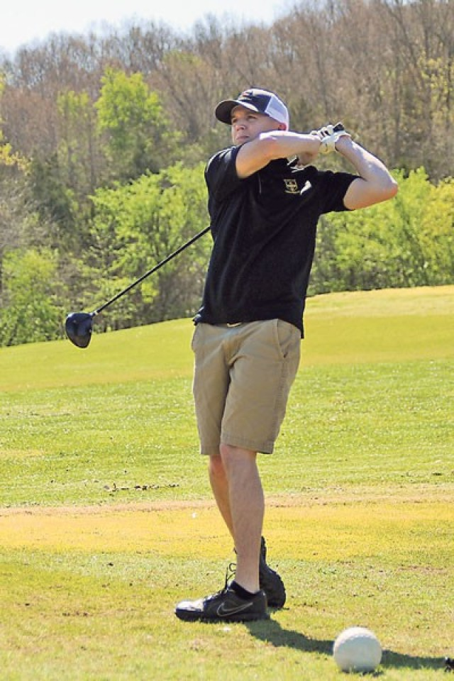 Clayton Pell tees off on Hole 1 Friday during the Commanding General's Scramble at Piney Valley Golf Course.
