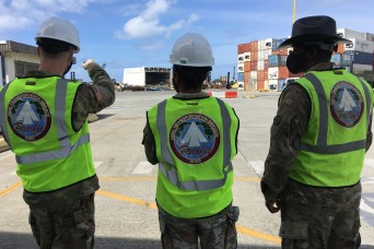 599th Trans. Bde. personnel monitor USMC barge offload