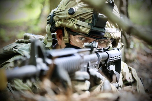 Staff Sgt. John Worst, a squad leader assigned to the 300th Chemical Company, 485th Chemical Battalion, 76th Operational Response Command, keeps an eye out for enemy movement during unit training operations at the Joint Readiness Training Center in Fort Polk, Louisiana, April 10, 2021.