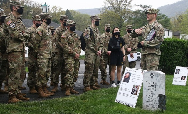 """Maj. Michael Sheehan, Company H-1 tactical officer, speaks to the Class of 2023 Company H-1 cadets about several recent graduates who died during the Global War on Terrorism, including 1st Lt. Timothy Steele, during the 16th annual """"Inspiration to Serve"""" Cemetery Tour April 29 at the West Point Cemetery."""