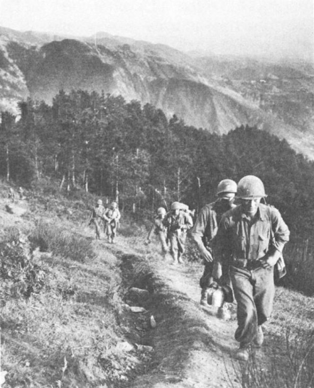 Members of the Army's 100th Infantry Battalion/442nd Regimental Combat Team make their way toward the Gothic Line, Germany's final, main defensive line in northern Italy during World War II. The line had sheer cliffs, some of which towered over 3,000 feet.