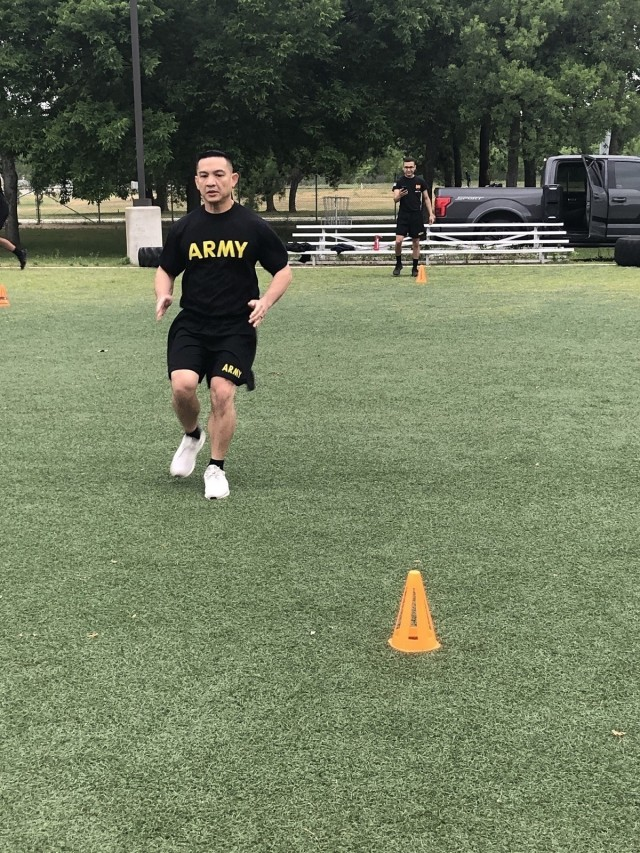 Staff Sgt. Paul Perdigon (left) and Staff Sgt. Brian Davis (right), Army Recovery Care Program Soldiers assigned to the Joint Base San Antonio Fort Sam Houston Soldier Recovery Unit, Texas, participated in a high intensity interval training session at Liberty Field on April 30, 2021. (Photo courtesy of Erik Holderby)