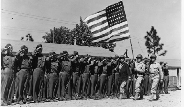 The U.S. Army 442nd Regimental Combat Team stands in formation at Camp Shelby, Miss., June 1943.
