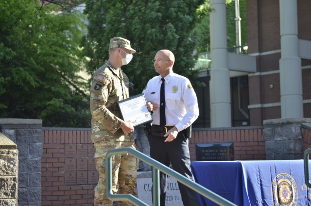 Corporal Bradley Dardas assigned to 2nd Battalion, 506th Infantry Regiment, 3rd Brigade Combat Team, 101st Airborne Division (Air Assault), receives a citizen commendation April 30 from Clarksville Police Department Chief David Crockarell for saving a man from drowning in the Cumberland River April 18.