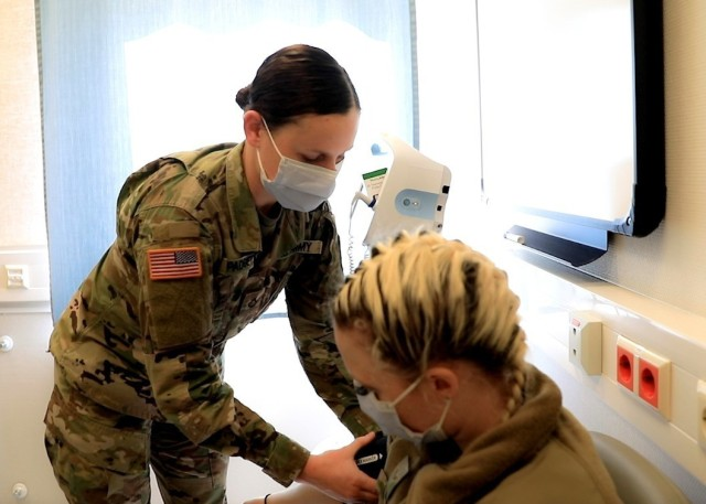 U.S. Army Pfc. Ragan Padgett (left), a healthcare specialist (formerly known as combat medic) with the Internal Medicine Clinic at Landstuhl Regional MC who was selected as the Medic of the Year for her contributions, takes a patients' vital signs at LRMC, April 23. Landstuhl Regional Medical Center recognized nurses, medics and technicians during National Nurses Week which is celebrated annually, May 6 to May 12. As part of this celebration of the medical professions, LRMC leaders select a team member to represent their fields and are lauded as the Advanced Practice Registered Nurse, Registered Nurse, Licensed Practical Nurse, Medic and Technician of the Year.