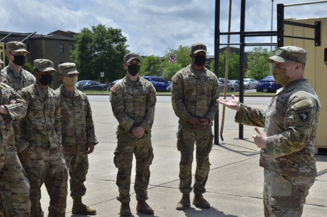 Staff Sergeant Noah Cole assigned to 2nd Battalion, 502nd Infantry Regiment, 2nd Brigade Combat Team, 101st Airborne Division (Air Assault), talks about his personal COVID-19 experience May 3 with other 2-502nd Soldiers.