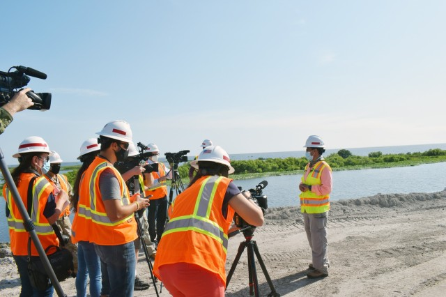 U.S. Army Corps of Engineers Jacksonville Project Manager, Ingrid Bon explains construction procedures with media at Lake Okeechobee during a media day April 14, 2021