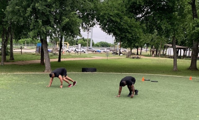As part of their adaptive reconditioning, Staff Sgt. Jaime Cruz and Pvt. Harrison Abong, Soldiers assigned to the Joint Base San Antonio Fort Sam Houston Soldier Recovery Unit, Texas, participated in a high intensity interval training session at Liberty Field on April 30, 2021. (Photo courtesy of Erik Holderby)