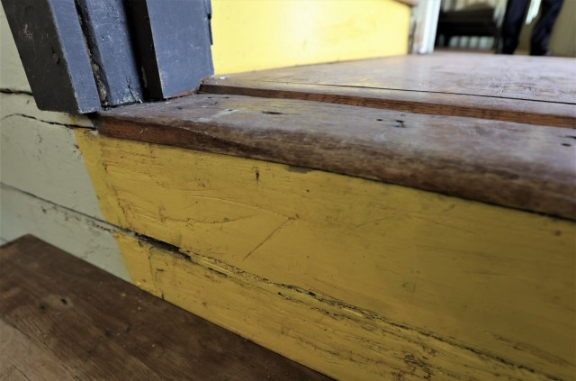 Having had combat boots scrape across them for nearly half a century, the visible wear on the steps demonstrates the many Soldiers who lived in the barracks. The latrine was also restored to its original condition.