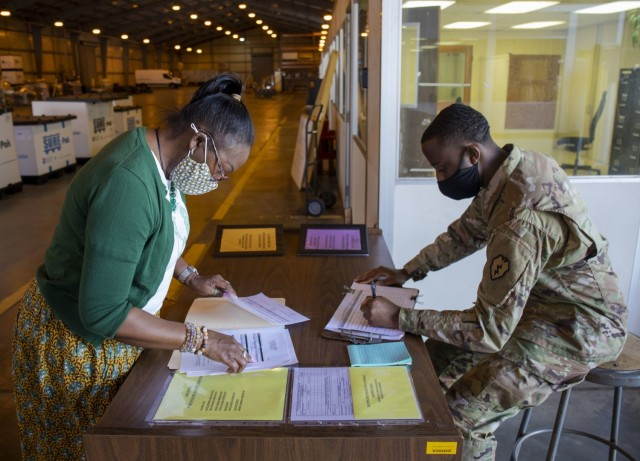 402nd Army Field Support Battalion-Hawaii's property book officer Reese Fontenot reviews the paperwork from a unit turning in excess equipment at the  Modernization, Displacement, and Repair Site. When a unit has equipment that no longer aligns with their mission, they set up an appointment with the MDRS to transfer the property accountability.