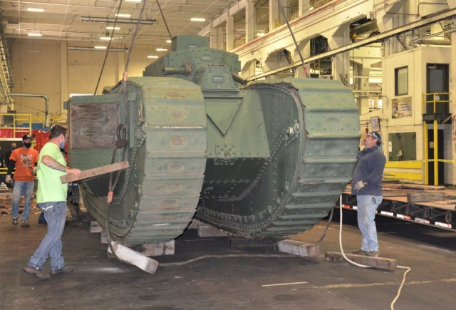 Once inside the facility at the Rock Island Arsenal – Joint Manufacturing and Technology Center, the unloading team assesses The Liberty Mark VIII tank. – Photo by Staci-Jill Burnley, Army Sustainment Command