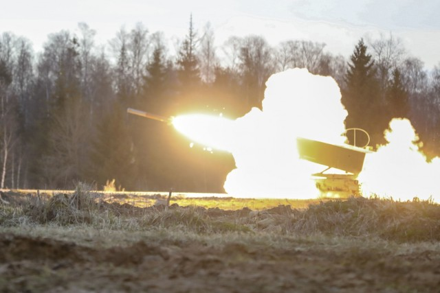 TAPA CENTRAL TRAINING AREA, Estonia — A U.S. Army M270 Multiple Launch Rocket System fires during a live fire exercise in support of Fires Shock, a series of fires exercises in support of DEFENDER-Europe 21 May 5, 2021. This portion of Fires Shock is in support of Swift Response 21, a linked exercise of DEFENDER-Europe 21, which involves special operations activities, air assaults, and live fire exercises in Estonia, Bulgaria, and Romania, demonstrating airborne interoperability among NATO allies. DEFENDER-Europe 21 is a large-scale U.S. Army-led exercise designed to build readiness and interoperability between the U.S., NATO allies and partner militaries. This year, more than 28,000 multinational forces from 26 nations will conduct nearly simultaneous operations across more than 30 training areas in more than a dozen countries from the Baltics to the strategically important Balkans and Black Sea Region. Follow the latest news and information about DEFENDER-Europe 21, visit www.EuropeAfrica.army.mil/DefenderEurope. (U.S. Army photo by Spc. Christian Cote).