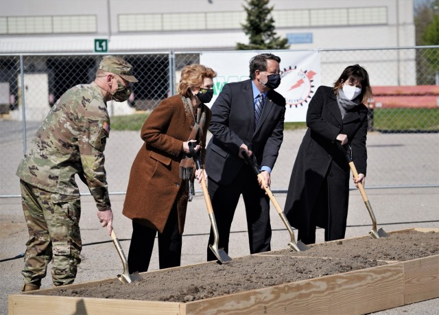 U.S. Senators from Michigan, Debbie Stabenow (center, left) and Gary Peters, join Maj. Gen. Darren Werner, commander of the Tank-automotive and Armaments Command and senior commander of Detroit Arsenal, along with Detroit Arsenal Garrison Manager Carrie Mead (far right), in turning a ceremonial shovel-full of dirt during an electrical substation groundbreaking ceremony held on Detroit Arsenal May 10.