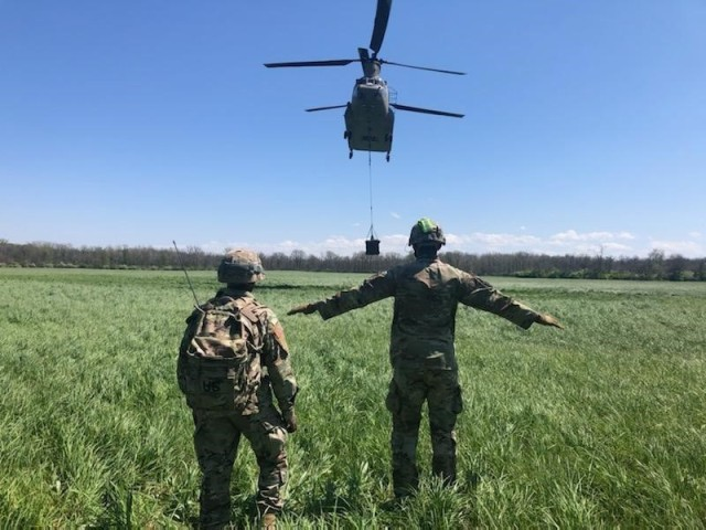 Soldiers from the 129th Combat Sustainment Support Battalion, 101st Division Sustainment Brigade, marks  the drop location for an aerial delivery in support of GR21 at Camp Atterbury, Ind., May 3, 2021.
