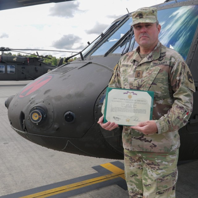 Master Sgt. Franklin holds Air Medal with Valor presented to him for Operation Commando Wrath
