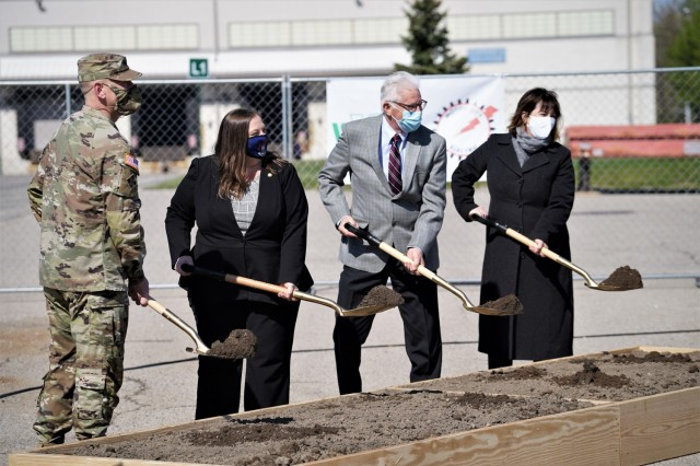 Michigan State Representative Lori Stone (center, left), and Michigan State Senator Paul Wojno, join Maj. Gen. Darren Werner, commander of the Tank-automotive and Armaments Command and senior commander of Detroit Arsenal, along with Detroit Arsenal Garrison Manager Carrie Mead (far right), in turning a ceremonial shovel-full of dirt during an electrical substation groundbreaking ceremony held on Detroit Arsenal May 10.
