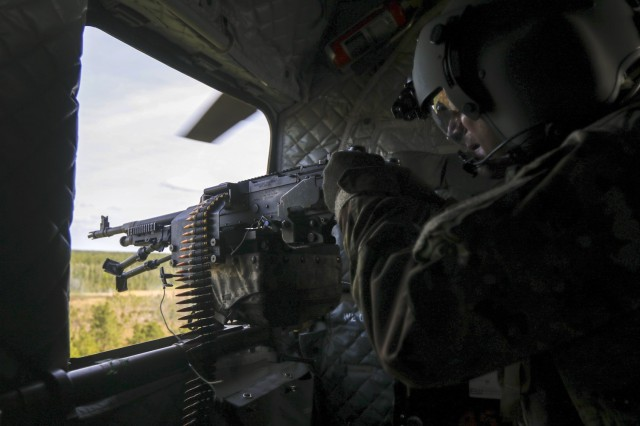 3rd Combat Aviation Brigade Command Sgt. Maj. Jason Huff scans for targets during aerial gunnery at Fort Stewart, Georgia, Apr. 27. Aerial gunnery allows Soldiers to train on their weapon systems to maintain the brigade's combat readiness. (U.S. Army photo by Spc. Savannah Roy, 3rd Combat Aviation Brigade, 3rd Infantry Division)