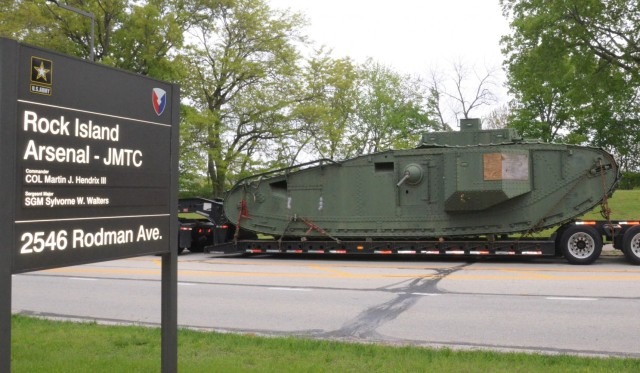 The historic Liberty Mark VIII tank, manufactured at Rock Island Arsenal 101 years ago in support of World War I, makes it way home through the streets of Moline, Illinois. The tank is only one of three left in existence. – Photo by Staci-Jill Burnley, Army Sustainment Command