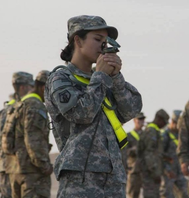 Spc. Christina Kring, human resources specialist, 510th Human Resources Company, Fort Eustis. Va., plots her coordinates during a land navigation course, Camp Arifjan, Kuwait, 2014. Kring, now a staff sergeant, currently serves as a recruiter with Catalina Recruiting Station, Tucson Recruiting Company, Phoenix Recruiting Battalion. (Courtesy Photo)