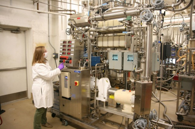 Dr. Anna Crumbley, a research chemical engineer, removes the solids from a new batch of fermented micro-organisms. The Chemical Biological Center is currently able to produce 1,000-liter batches of biomanufactured material at its Aberdeen Proving Ground facility, and will be expanding that capacity when Phase 2 of the facility is completed.