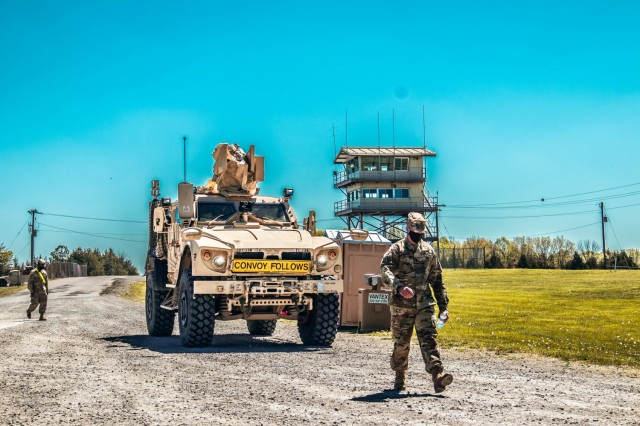 Sgt. 1st Class Shannon Lincoln guiding in the Battalion Commander's, Lt. Col. Shelia Day, vehicle for the 129th Combat Sustainment Support Battalion, 101st Division Sustainment Brigade, at Fort Knox, Ky. May 2, 2021.