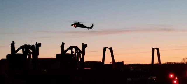 The Aviation Soldiers conduct aerial security as the sun sets over Camp Atterbury, Ind., as 129th Combat Sustainment Support Battalion, 101st Division Sustainment Brigade, closes out operations for GR21.