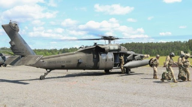 A group of U.S. Army Soldiers assigned to 3rd Combat Aviation Brigade, 3rd Infantry Division, exit a UH-60L Black Hawk helicopter after performing a successful aerial gunnery exercise on Fort Stewart, Georgia, April 27, 2021. Aerial gunneries allow Soldiers to train on mission essential tasks, and improves the brigade's combat readiness. (U.S. Army photo by Pvt. Anthony Ford)