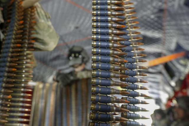 Belts of 7.62 mm ammunition sit ready to be loaded and fired from a CH-47 Chinook helicopter during aerial gunnery at Fort Stewart, Georgia, Apr. 27. Aerial gunnery allows Soldiers to train on their weapon systems to maintain the brigade's combat readiness. (U.S. Army photo by Spc. Savannah Roy, 3rd Combat Aviation Brigade, 3rd Infantry Division)