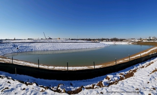 After the first snow of the year, a view of the north cooling pond at the N2W site in St. Louis, Mo. at the Next National Geospatial-Intelligence Agency West Headquarters site under construction in St. Louis, Mo. February 2, 2021. The building complex is expected to be occupied in 2025.