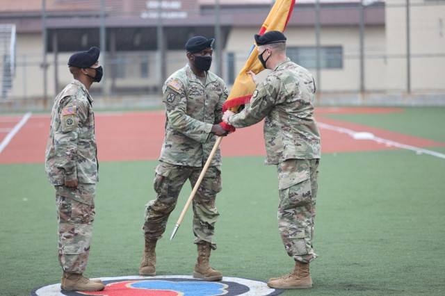 Brig. Gen. Steven Allen, commander, 19th Expeditionary Sustainment Command, receives the command colors from Command Sgt. Maj. LaDerek Green, command sergeant major, 19th ESC, during a relinquishment of responsibility ceremony on Camp Walker, Republic of Korea.