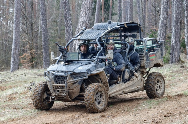 Members of the opposing forces team from 1st Battalion, 4th Infantry Regiment prepare to deploy smoke from the back of their all-terrain vehicle during the Dragoon Ready 21 training exercise at Hohenfels Training Area, Germany, April 19, 2021. Dragoon Ready 21 is a 7th Army Training Command-led exercise conducted in HTA, Germany. (U.S. Army photo by Master Sgt. Ryan C. Matson)