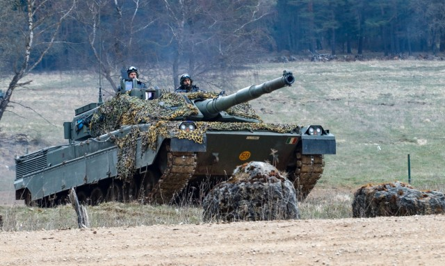 Italian tankers acting as opposing forces prepare to engage the 2nd Cavalry Division during the culminating battle of the Dragoon 21 training exercise at Hohenfels Training Area, Germany, April 19, 2021. Dragoon Ready 21 is a 7th Army Training Command-led exercise conducted in HTA, Germany. (U.S. Army photo by Master Sgt. Ryan C. Matson)