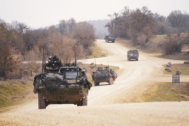 U.S. Army Stryker vehicle variants, assigned to the 2d Cavalry Regiment, maneuver downhill during Dragoon Ready 21 at the Hohenfels Training Area, Germany, April 19, 2021. DR21 is a 7th Army Training Command led exercise designed to ensure readiness and certify 2CR in NATO combat readiness and unified land operations, strengthening alliances and delivering more effective coalition operations essential to a safe and secure environment. (U.S. Army photo by Sgt. LaShic Patterson)
