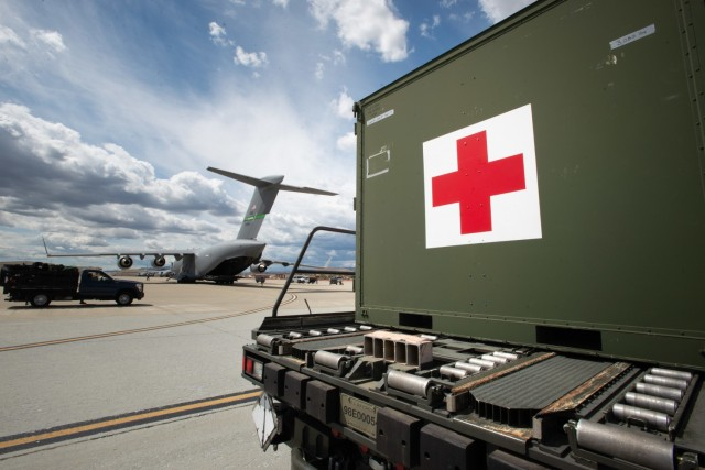 A Litter Station Augmentation Set sits on the flight line at Travis Air Force Base, California, prior to being loaded on to a C-17 Globemaster III during Exercise Nexus Dawn on April 26, 2021. The LSAS is critical to successfully executing emergency missions if additional stanchions and litters are needed by Air Force Reserve aeromedical evacuation teams. Exercise Nexus Dawn presents realistic and challenging combat readiness scenarios in which Reserve Citizen Airmen are tested and evaluated at how well they can execute their mission. (U.S. Air Force photo by Dennis Santarinala)