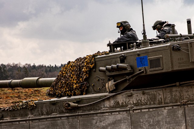Italian tankers convoy and patrol for enemy forces through Hohenfels Training Area, Germany, in exercise Dragoon Ready 21, April 19, 2021. The Italian tank unit joined the native opposition force to the Joint Multinational Readiness Center, 1st Battalion, 4th Infantry Division, and members of the Latvian Army, in an offensive on the last day of the exercise. (U.S. Army photo by Staff Sgt. Christopher Stewart)