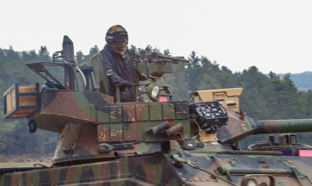 An opposing forces Soldier from 1st Battalion, 4th Infantry Regiment maneuvers through the rain during the culminating battle of the Dragoon 21 training exercise at Hohenfels Training Area, Germany, April 19, 2021. Dragoon Ready 21 is a 7th Army Training Command-led exercise conducted in HTA, Germany. (U.S. Army photo by Master Sgt. Ryan C. Matson)