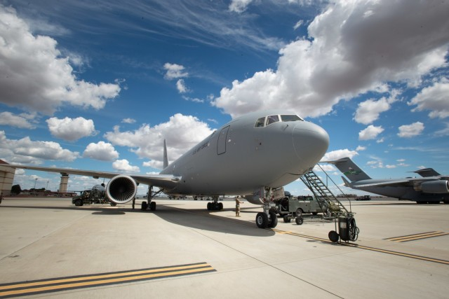 A KC-46A Pegasus from the 931st Air Refueling Wing at McConnell Air Force Base, Kansas, sits on the flight line at Travis Air Force Base, California, prior to a refueling mission supporting Exercise Nexus Dawn, April 26, 2021. The Pegasus is the Air Force's newest air refueling tanker, and is expected to join the Team Travis inventory in 2023. (U.S. Air Force photo by Dennis Santarinala)
