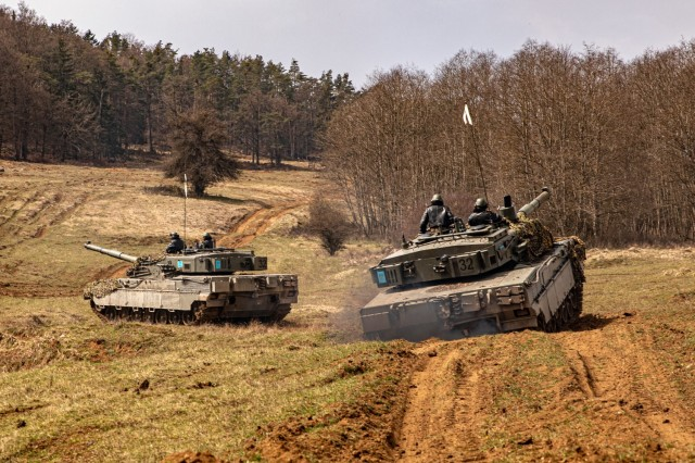 Italian tankers convoy through Hohenfels Training Area, Germany, to find and engage with the opposing forces in exercise Dragoon Ready 21, April 19, 2021. The Italian tank unit joined the native opposition force to the Joint Multinational Readiness Center, 1st Battalion, 4th Infantry Division, and members of the Latvian Army, in an offensive on the last day of the exercise. (U.S. Army photo by Staff Sgt. Christopher Stewart)