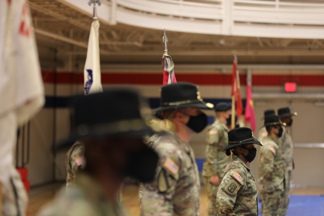Capt. Neisha Bailey, the 602nd Maintenance Company commander, stands with other 553rd Division Sustainment Support Battalion company commanders and guidons during a conversion ceremony April 16 at Fort Hood. The 602nd was redesignated as B Company during the ceremony.