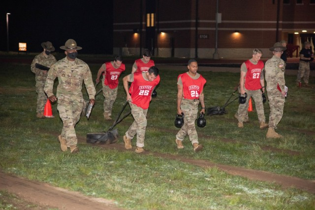 1st Lt. Ralpael Eirea and Staff Sgt. Johnny Gray assigned to 9th Engineer Battalion, 2nd Armored Brigade Combat Team, 3rd Infantry Division, participate in a non standard army physical fitness test apart of the Best Sapper Competition on Fort Leonard Wood, Missouri May 1, 2021. (courtesy photo)