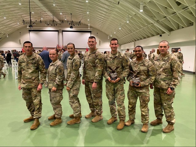 Lt. Col. Brian T. Looney(Middle), Command Sgt. Maj. Oscar Rodriguez (last on right), Master Sgt. Joushua Spaulding(first on left), 1st Lt. Trisha Burden (third from left), 1st Lt. Ralpael Eirea(third from right), 2nd Lt. Amanda Atkinson(second from left), and Staff Sgt. Johnny Gray(second from right),all assigned to 9th Engineer Battalion, 2nd Armored Brigade Combat Team, 3rd Infantry Division, pose for a picture after the Best Sapper award ceremony at  Nutter Field-house on Fort Leonard Wood, Missouri April 4, 2021. (Courtesy Photo)