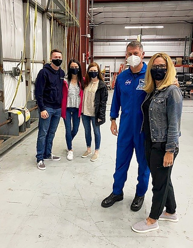(From left to right) Class of 2022 Cadet Zachary Kimbrough posing alongside  his sisters and his dad, Robert Kimbrough, and his mom, Robbie, before Robert departs to space. Through this launch on April 23, Robert became the fourth person ever to fly in three different spacecrafts and the only living American to do so. (Courtesy Photo)