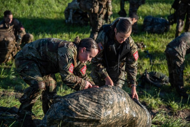 1st Lt. Trisha Burden(right) and 2nd Lt. Amanda Atkinson(left) assigned to 9th Engineer Battalion, 2nd Armored Brigade Combat Team, 3rd Infantry Division, participate in a Poncho Raft Swim apart of the Best Sapper Competition on Fort Leonard Wood, Missouri May 1, 2021. (Courtesy photo)