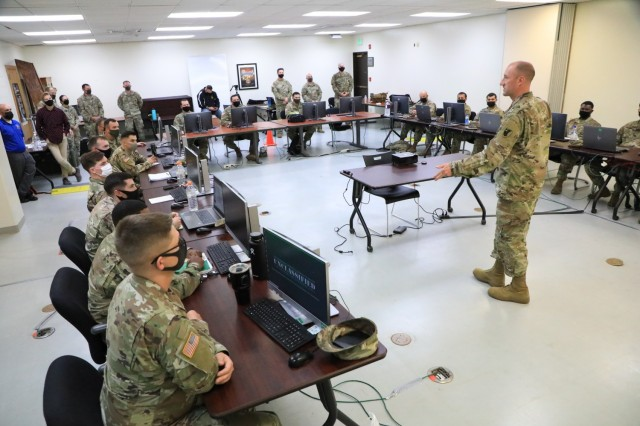 Command Sgt. Maj. Kellen C. Rowley, 38th Air Defense Artillery Brigade senior enlisted advisor, speaks to the students of Patriot Master Gunner course class 701-21 students about the importance of the knowledge the course offers during a visit at Kadena Air Base, Japan April 29. The Patriot Master Gunner Course is currently being held in Japan for the first time from April 19 to June 28, 2021.