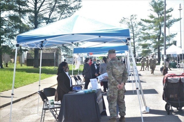 Screaming Eagle Soldiers and Army spouses speak to potential employers May 6 during the Open Air Hiring Fair at the Spouse Employment Center.