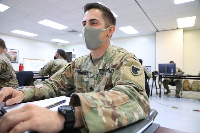 Staff Sgt. Roberto Maldonado, Patriot Master Gunner course student and Patriot fire control enhanced operator, Battery D, 1st Battalion, 1st Air Defense Artillery Regiment, works through his classroom studies during the PMG course at Kadena Air Base, Japan April 29. Air Defenders across the Indo-Pacific region are gaining an advanced understanding of air defense operations, standards, and doctrine during PMG class 701-21 hosted by the 1st Battalion, 1st Air Defense Artillery Regiment at Kadena Air Base from April 19 to June 28, 2021.