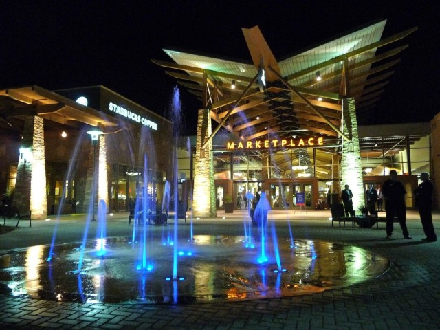 The night silhouette of the main entrance to the Freedom Crossing shopping center at Fort Bliss, Texas, 2012. Opened in 2010, the Army and Air Force Exchange Service shopping and entertainment complex was the first of its kind on an Army or Air Force installation. AAFES helps to fund family support and recreational services on Army and Air Force installations.